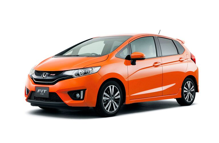 Driver side exterior view of an orange 2015 Honda Fit