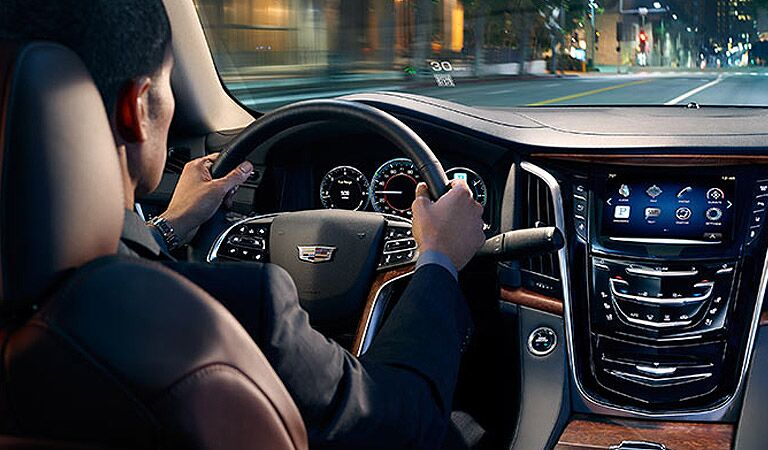Image of a man behind the wheel of the 2015 Cadillac Escalade