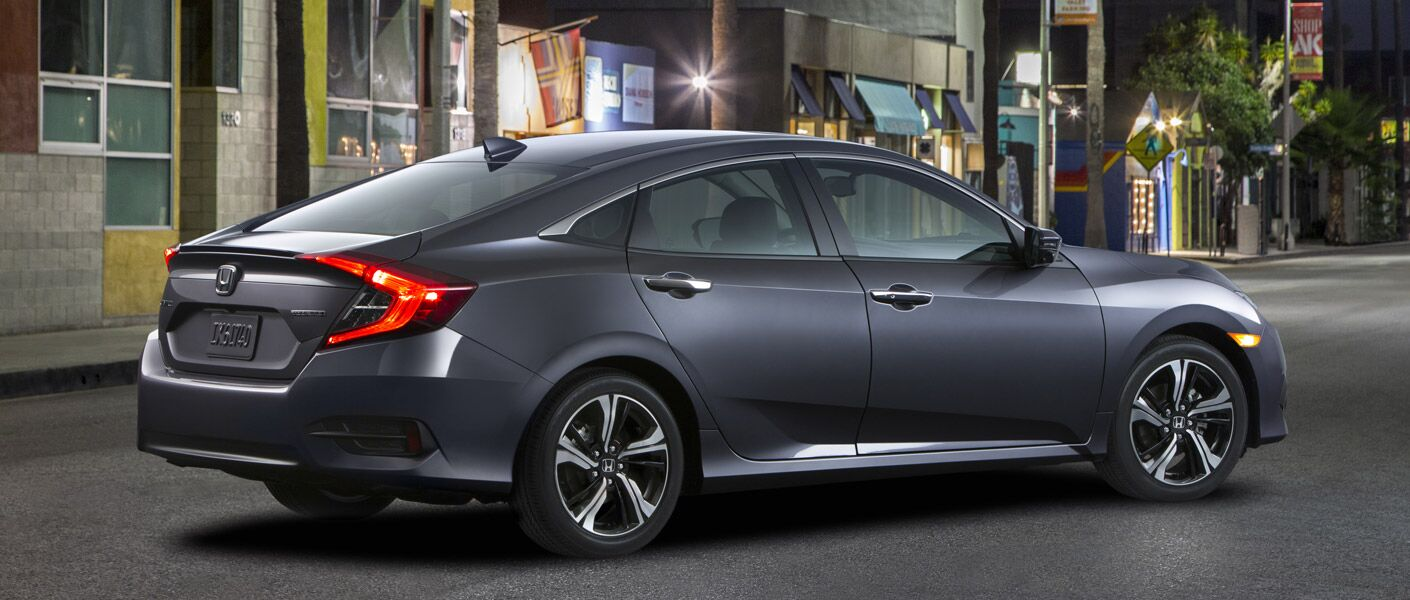 Profile view of gray 2016 Honda Civic parked on city street