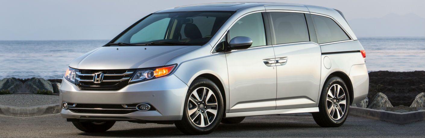 Driver side exterior view of a gray 2016 Honda Odyssey