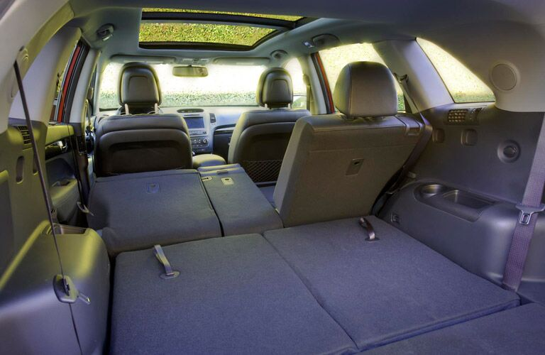 Rear seats split folded for storage convenience in the 2016 Kia Sorento