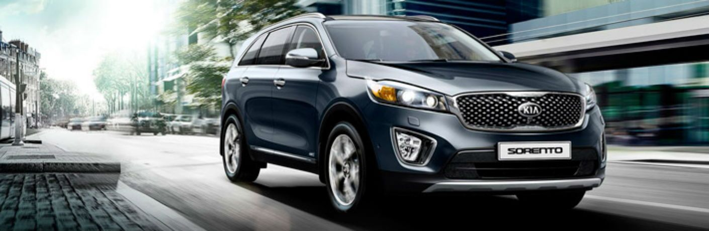 Front passenger side exterior view of a blue 2016 Kia Sorento