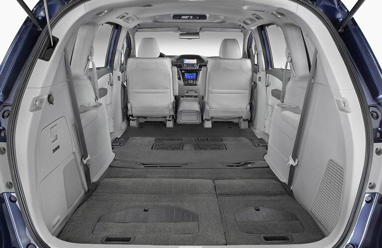 Rear seats folded flat for storage in the 2016 Honda Odyssey