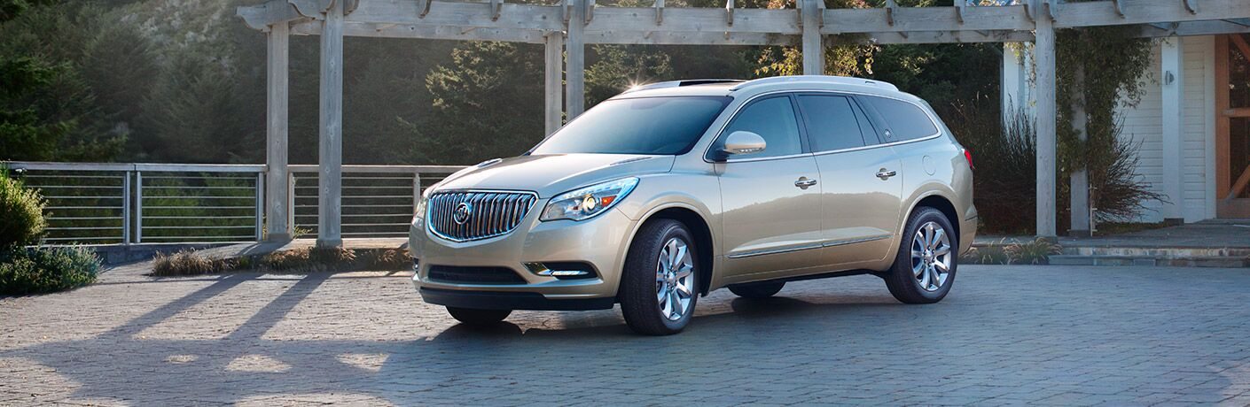 Driver side exterior view of a gold 2017 Buick Enclave