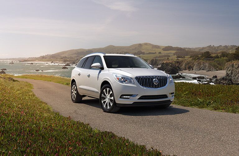 Front passenger side exterior view of a white 2017 Buick Enclave
