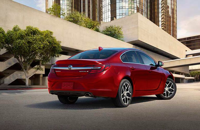Rear passenger side exterior view of a red 2017 Buick Regal