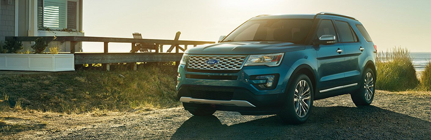 Front driver side exterior view of a blue 2017 Ford Explorer