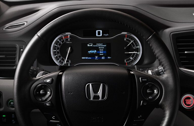 Steering wheel mounted controls and driver information cluster of the 2017 Honda Pilot