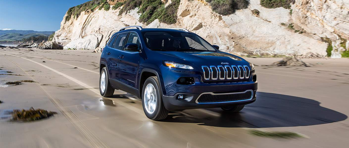 Front exterior view of a blue Jeep Cherokee