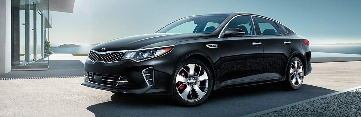 Driver's side exterior view of a black Kia Optima