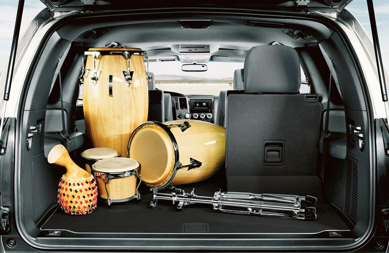 Rear seat of the 2017 Toyota Sequoia split-folded to fit a large set of bongo drums