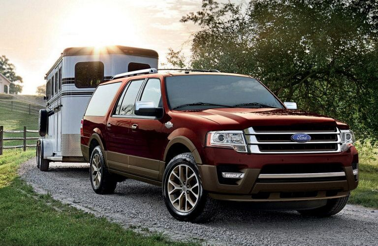 Front passenger side exterior view of a red 2017 Ford Expedition