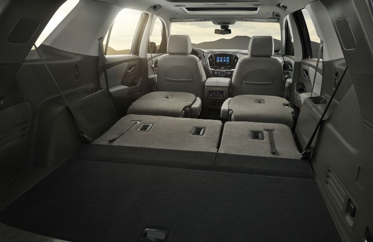 Rear seats folded flat for storage in the 2018 Chevy Traverse