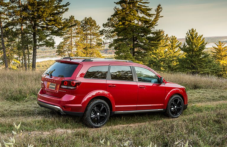 Rear passenger side exterior view of a red 2018 Dodge Journey