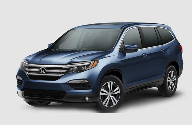 Front driver side exterior view of a blue 2018 Honda Pilot