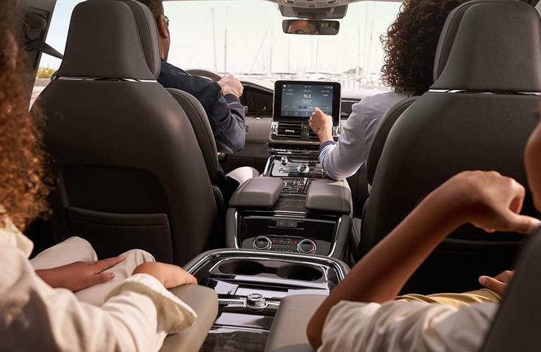 2018 Lincoln Navigator front and second row with a family