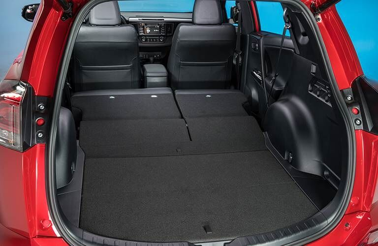 Cargo space in a red 2016 Toyota RAV4