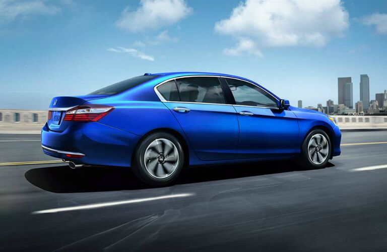 blue 2016 Honda Accord driving on city highway