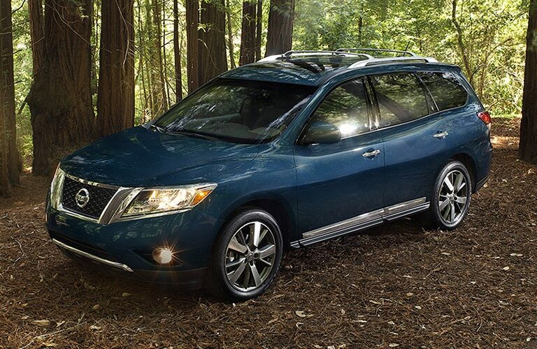 2016 blue Nissan Pathfinder in the woods