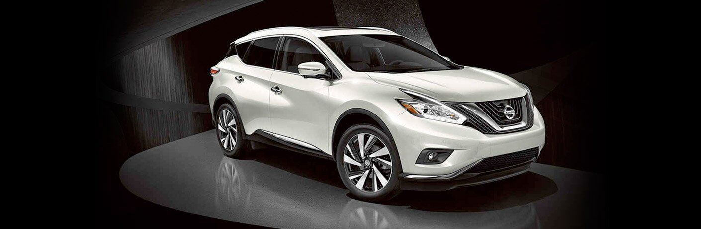 Silver 2017 Nissan Murano in front of black bacground