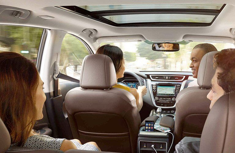 2017 Nissan Murano beige Interior with happy passengers