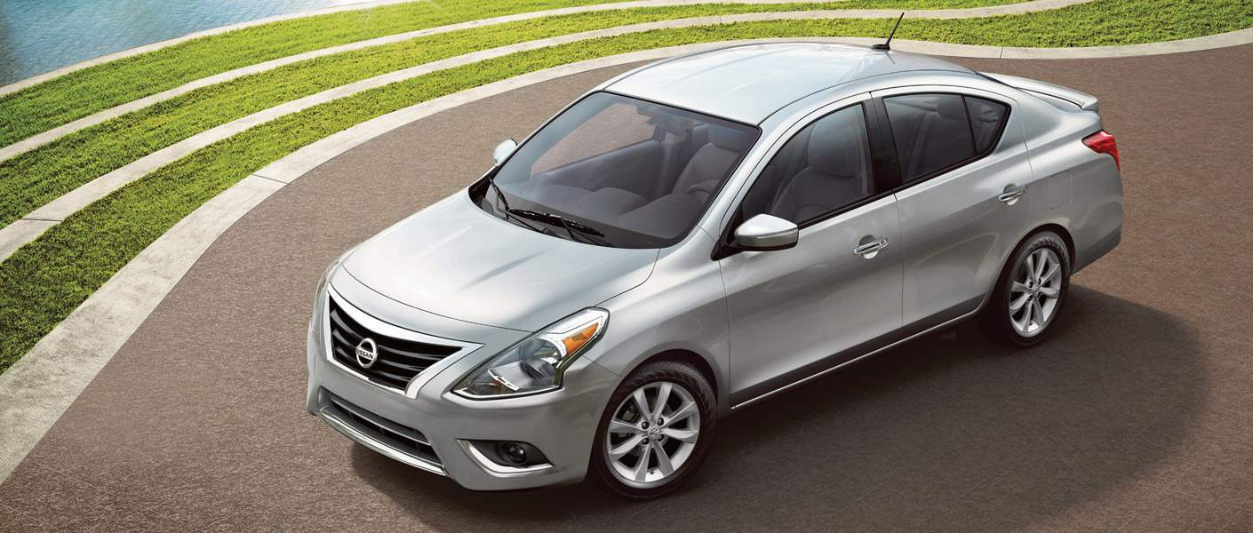 2017 Nissan Versa available in Tamuning Guam. Parked next to grass
