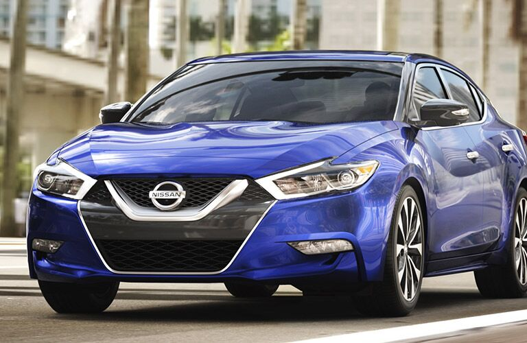 blue nissan maxima, silver v-motion grille, front of car