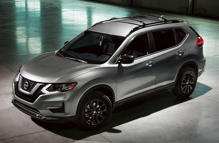 dark gray nissan rogue parked in garage