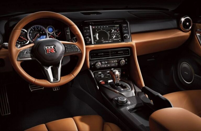 Interior view of the front seating area inside a 2019 Nissan GT-R