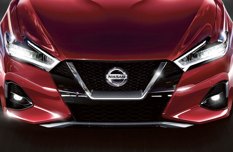 Exterior view of the front hood and grille on a red 2019 Nissan Maxima