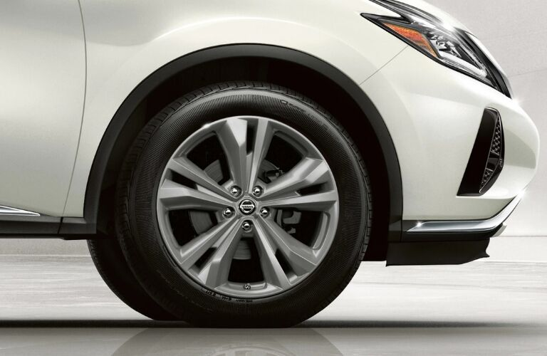 Exterior view of the front passenger's side tire on a white 2019 Nissan Murano