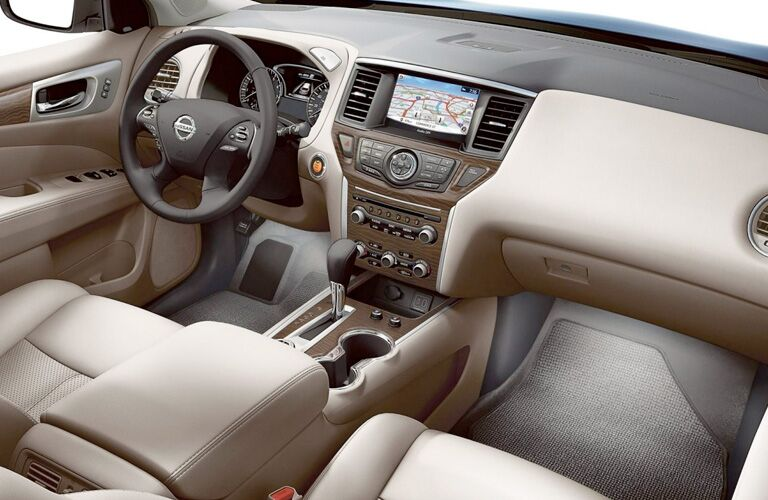 Interior view of the steering wheel and touchscreen inside a 2019 Nissan Pathfinder