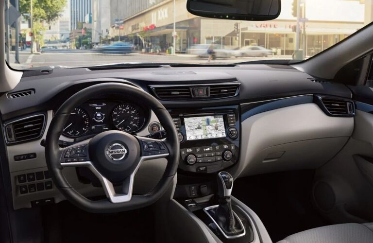 Interior view of the steering wheel and navigation screen inside a 2019 Nissan Rogue Sport