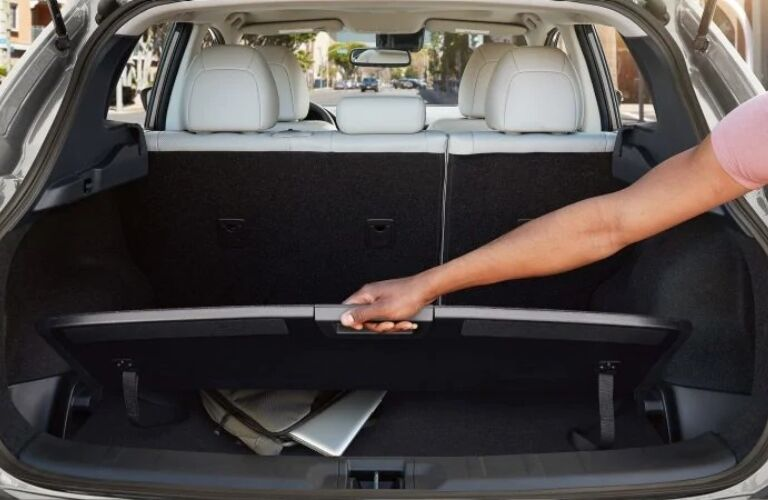 Interior view of the rear cargo and Divide-and-Hide storage area inside a 2019 Nissan Rogue Sport