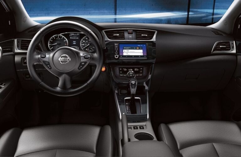 Interior view of the front seating area inside a 2019 Nissan Sentra