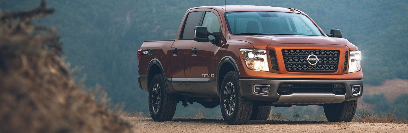 2019 Nissan Titan orange on dirt road