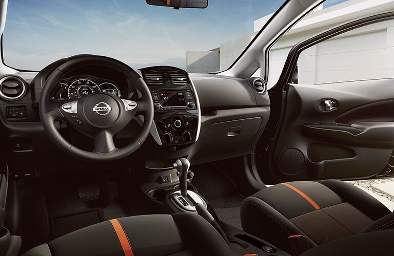 Interior view of the steering wheel and front seating area inside a 2019 Nissan Versa Note