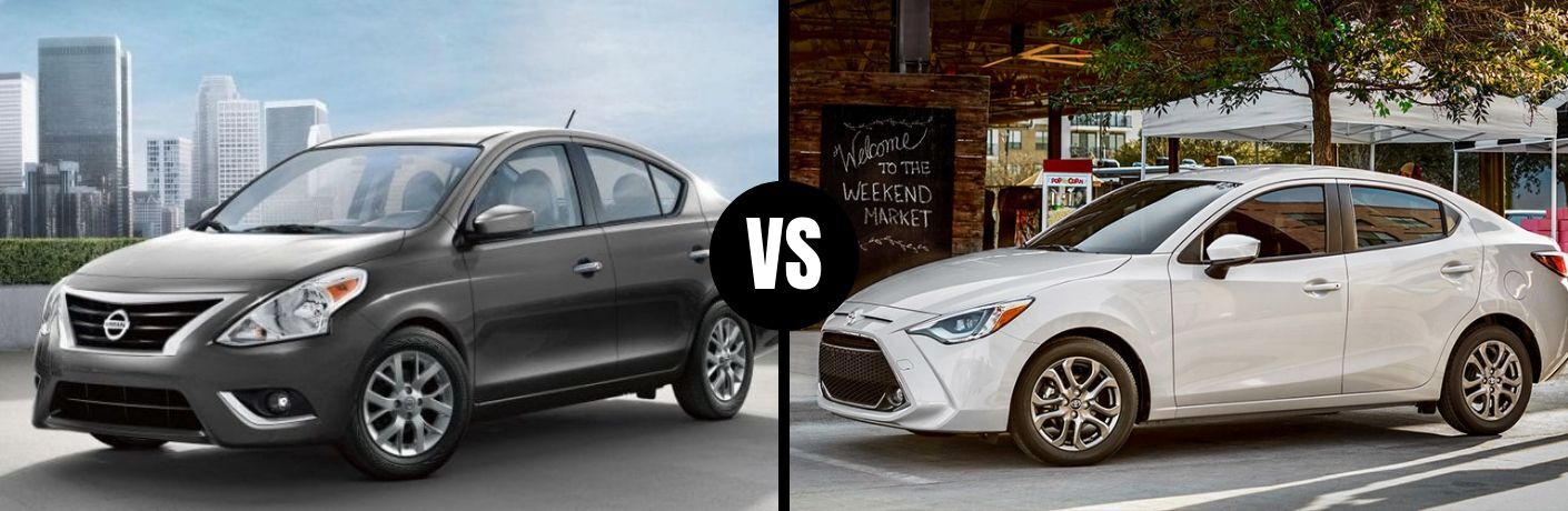 Comparison image of a gray 2019 Nissan Versa Sedan and a white 2019 Toyota Yaris Sedan