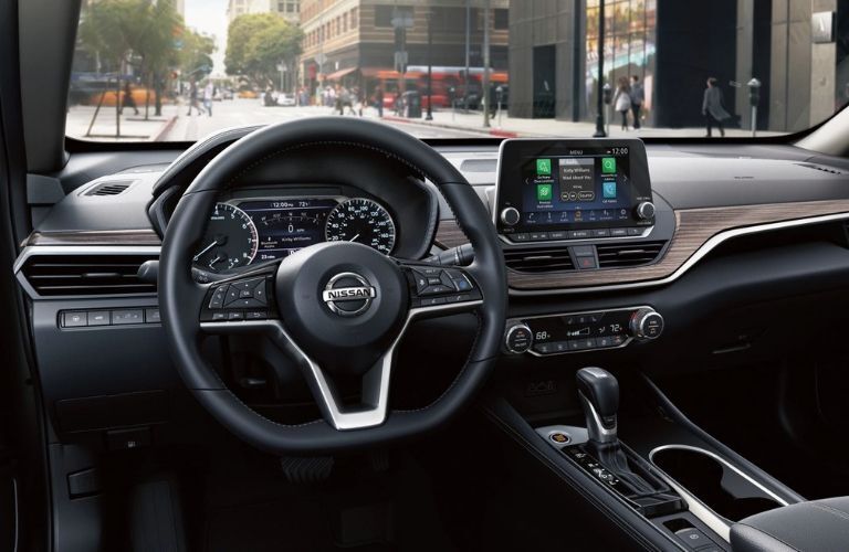 Interior view of the steering wheel and touchscreen inside a 2020 Nissan Altima