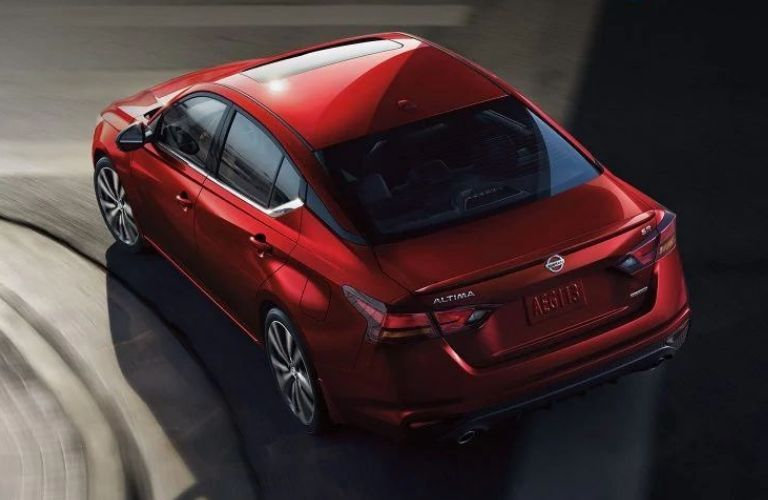 Exterior view of the rear of a red 2020 Nissan Altiam