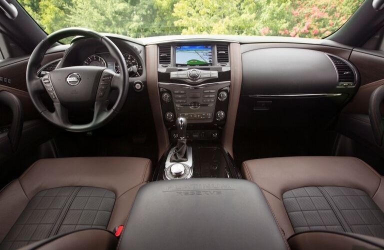 Interior view of the steering wheel and touchscreen inside a 2020 Nissan Armada