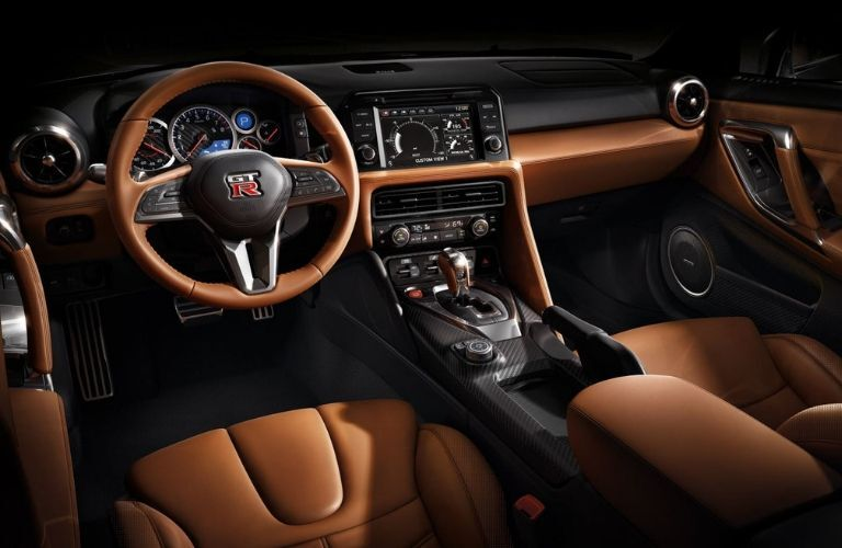 Interior view of the front seating area inside a 2020 Nissan GT-R