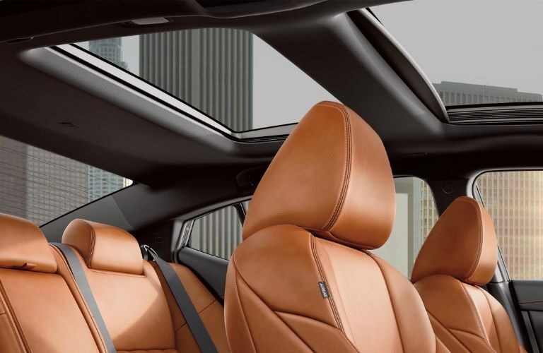 Interior view of the tan seating and sunroof inside a 2020 Nissan Maxima
