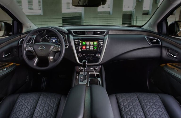 Interior view of the steering wheel and touchscreen inside a 2020 Nissan Murano