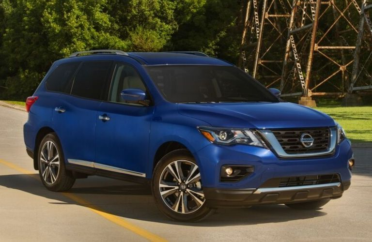Exterior view of the front of a blue 2020 Nissan Pathfinder