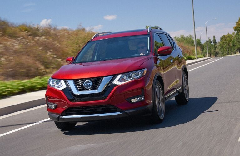 Exterior view of the front of a red 2020 Nissan Rogue