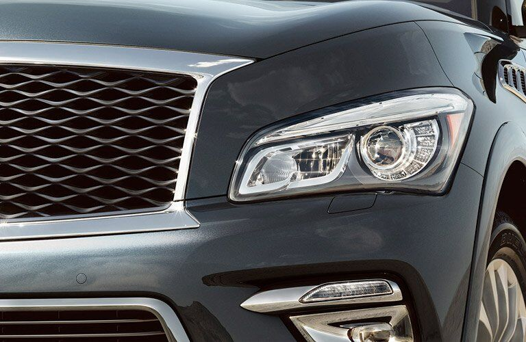 grille and headlight of black infiniti qx80