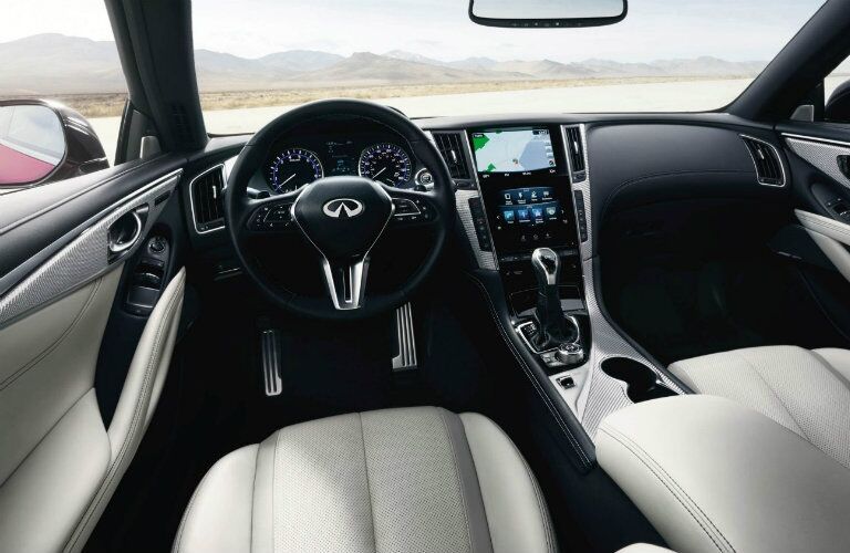 Interior view of the black steering wheel and touchscreen inside a 2019 INFINITI Q60