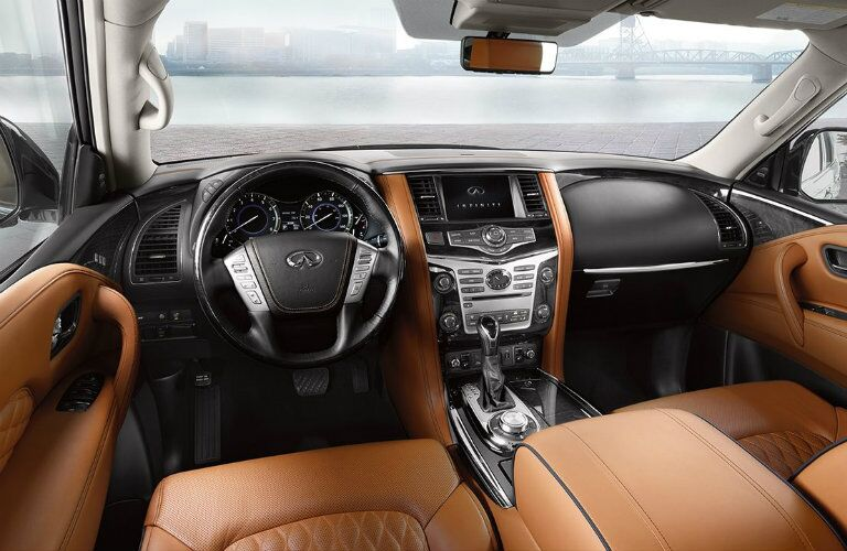 Interior view of the black steering wheel and touchscreen inside a 2019 INFINITI QX80