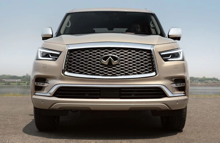 Exterior view of the front of a beige 2019 INFINITI QX80